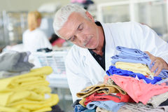 Man with pile clothings Royalty Free Stock Photo