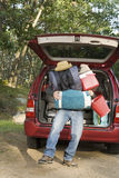 Man with pile of luggage Royalty Free Stock Photo