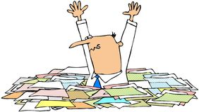 Man in a pile of papers Royalty Free Stock Images