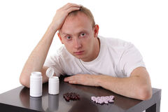 Man and pills Stock Photo