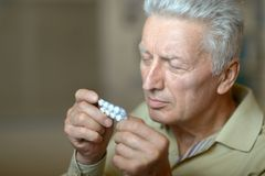 Man with pills Royalty Free Stock Photography