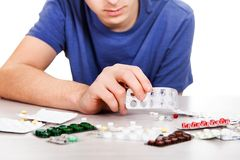 Man with a pills. On the table closeup royalty free stock photo