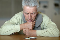 Man with pills Stock Photos