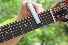 The man pin capo to the guitar Stock Photography