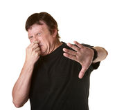 Man Pinches His Nose. Mature Caucasian man on white background pinches his nose Stock Photography