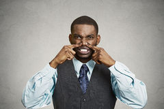 Man pinches his nose, very bad smell, odor Royalty Free Stock Photo