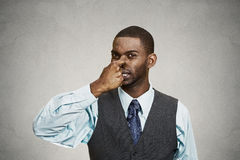 Man pinches his nose, very bad smell, odor Stock Photo