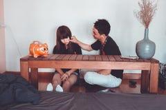 Man Pinching the Cheek of Woman Sitting Near Rectangular Brown Wooden Coffee Table Stock Image
