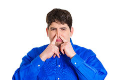 Man pinching his nose Royalty Free Stock Photos