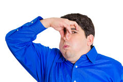 Man pinching his nose Stock Image
