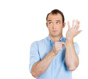 Man pinching his skin Royalty Free Stock Images