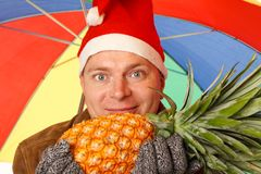 Man with pineapple Royalty Free Stock Images
