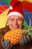 Man with pineapple Royalty Free Stock Photo
