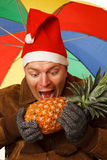 Man with pineapple. Royalty Free Stock Photo