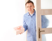 Man with pink gift Royalty Free Stock Photography