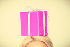 Man with pink gift box on his head. Celebration and giving concept. Young man with pink gift box on his head. Guy have idea for present Royalty Free Stock Photography