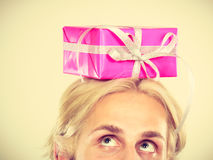 Man with pink gift box on his head. Celebration and giving concept. Young man with pink gift box on his head. Guy have idea for present Royalty Free Stock Photo