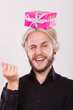 Man with pink gift box on his head. Celebration and happiness concept. Cool happy young man with pink gift box on his head. Guy have crazy idea for present Royalty Free Stock Photography