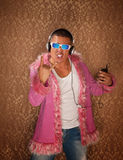 Man in Pink Jacket Listens to Music Stock Photos