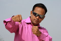 Man in pink shirt boxing Royalty Free Stock Photography
