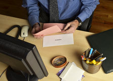 Man with pink slip Royalty Free Stock Photography