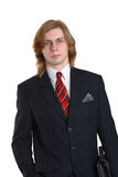 Man in pinstriped suit. Young man with long blond hair wearing dark pinstriped business suit.  White background Royalty Free Stock Photography