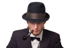 Man with a pipe in hat Royalty Free Stock Image