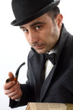 Man with   pipe and hat bowler Stock Images