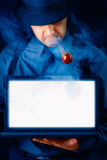 Man with Pipe Holding Laptop with White Screen Stock Photography
