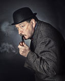 Man with a pipe Stock Photography