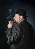Man with a pipe Royalty Free Stock Photos