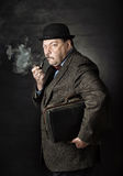 Man with a pipe Stock Photo