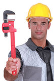 Man with a pipe wrench Stock Photo