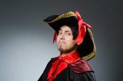 Man pirate against dark background. The man pirate against dark background royalty free stock image