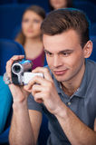 Man pirating at the cinema. Stock Photo