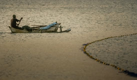 Man in a pirogue Stock Photo