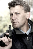 Man with pistol. Royalty Free Stock Images