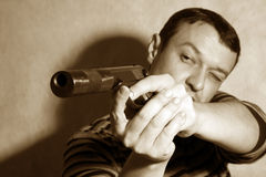 Man with a pistol Stock Photography