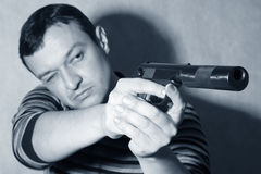 Man with a pistol Stock Images