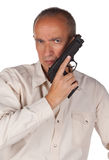 Man with pistol. Isolated in white background Stock Image