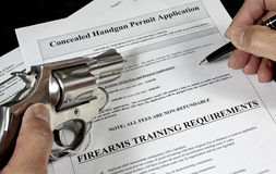 Man with pistol and handgun permit application Stock Photos