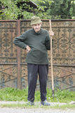 A man with the pitchfork in Romania Stock Photo