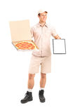 Man from pizza delivery service holding a clipboard Royalty Free Stock Photos