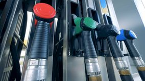 Man places a nozzle on a tank at a modern gas station. Man places a nozzle on a tank after usage stock footage