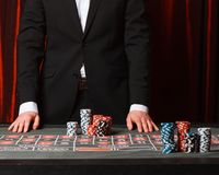 Man placing a bet at the casino. Studio shot stock photos