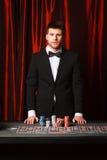 Man placing a bet at the casino Royalty Free Stock Photos