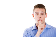 Man placing finger on lips as if to say, shhhhh, be quiet, silence Stock Photography
