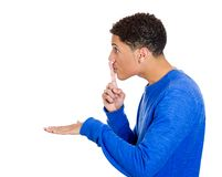 Man placing fingers on lips with shhh sign Royalty Free Stock Images