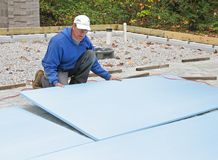 Man placing foam insulation Stock Photo