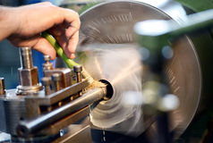 Man placing lubricating oil on a lathe Royalty Free Stock Images